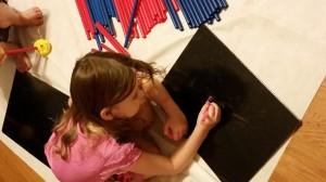 "Aleya writes her letter ""E"""